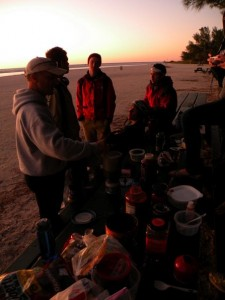 The 2008 Metanoia group cook their dinner on the beach as the sun sets// Christian Hagenlocher