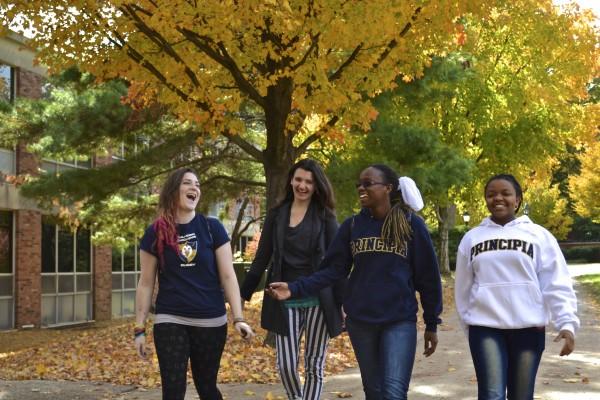 Freshmen Frannie Dankin-White, Gemma Ritchie, Victoria Scott, and Christine Hadassah catch up. Photo credit Kimberly Sheasley