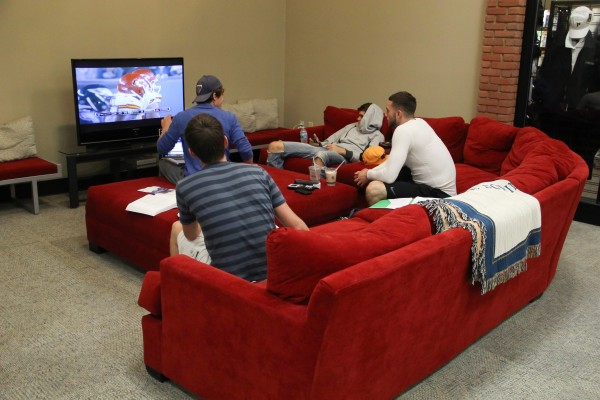 Students enjoy watching sports games on the new comfy couches. photo/Daren Huber